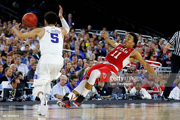 Tyus Jones of the Duke Blue Devils and Brandon Taylor of the Utah Utes collide in the second half during a South Regional Semifinal game of the 2015...