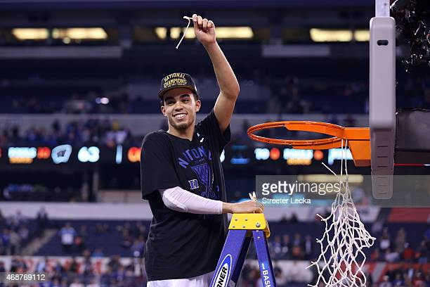 Tyus Jones of the Duke Blue Devils cuts down the net after defeating the Wisconsin Badgers during the NCAA Men's Final Four National Championship at...