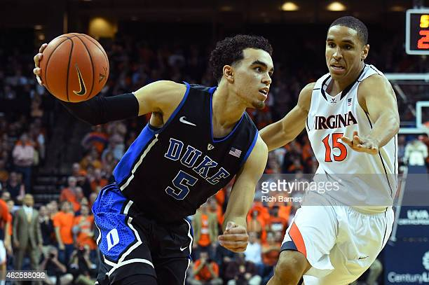 Tyus Jones of the Duke Blue Devils drives to the basket past Malcolm Brogdon of the Virginia Cavaliers during the second half at John Paul Jones...