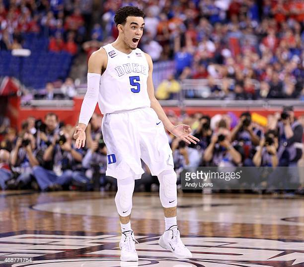 Tyus Jones of the Duke Blue Devils reacts after a three point basket late in the second half against the Wisconsin Badgers during the NCAA Men's...