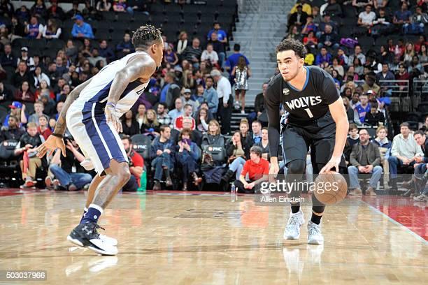 Tyus Jones of the Minnesota Timberwolves dribbles the ball against the Detroit Pistons on December 31 2015 at The Palace of Auburn Hills in Auburn...