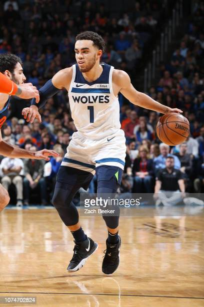 Tyus Jones of the Minnesota Timberwolves dribbles the ball during the game against Alex Abrines of the Oklahoma City Thunder on December 23, 2018 at...
