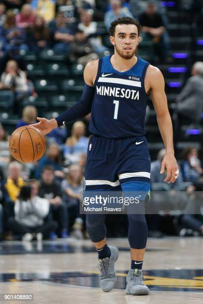 Tyus Jones of the Minnesota Timberwolves dribbles with the ball against the Indiana Pacers during the first half at Bankers Life Fieldhouse on...