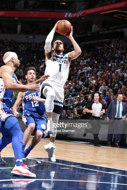 Tyus Jones of the Minnesota Timberwolves drives to the basket against the Philadelphia 76ers on December 12 2017 at Target Center in Minneapolis...