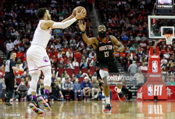 Tyus Jones of the Minnesota Timberwolves grabs pass defended by James Harden of the Houston Rockets in the first half at Toyota Center on March 17...