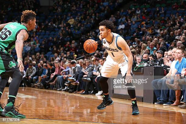 Tyus Jones of the Minnesota Timberwolves handles the ball against Marcus Smart of the Boston Celtics on February 22 2016 at Target Center in...