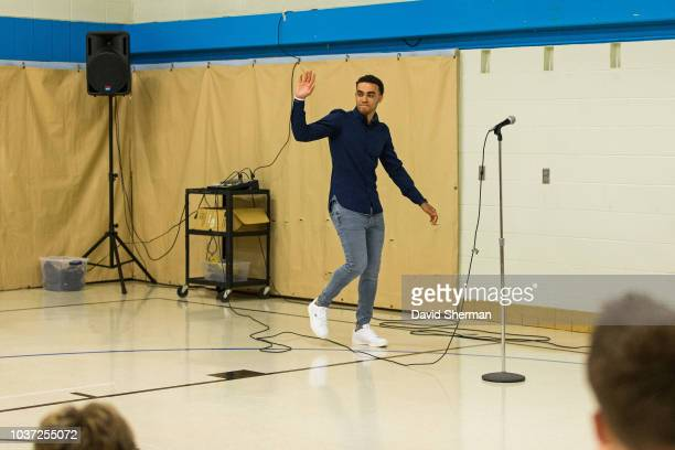 Tyus Jones of the Minnesota Timberwolves in partnership with TCL Principal Tami StalochSchultz and Apple Valley MN Mayor Mary HamannRoland unveil a...
