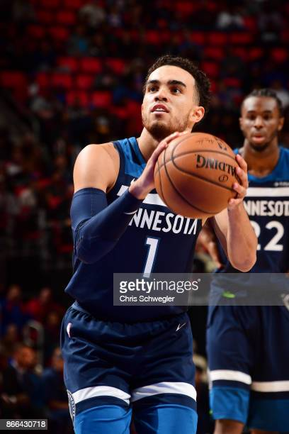 Tyus Jones of the Minnesota Timberwolves shoots the ball against the Detroit Pistons on October 25 2017 at Little Caesars Arena in Detroit Michigan...