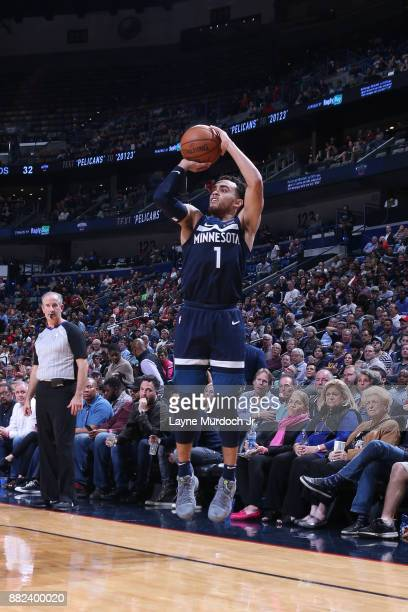 Tyus Jones of the Minnesota Timberwolves shoots the ball against the New Orleans Pelicans on November 29 2017 at Smoothie King Center in New Orleans...