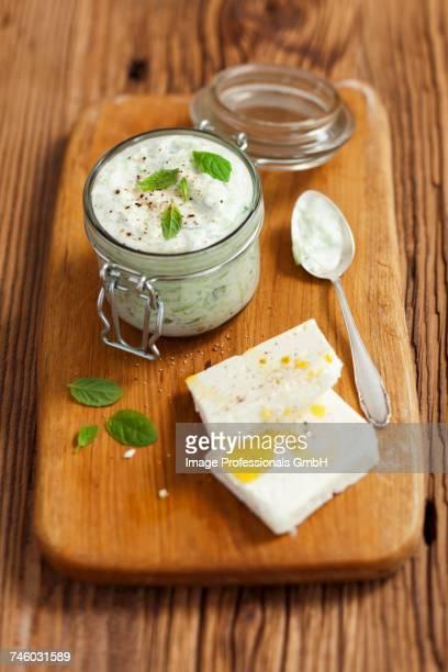 tzatziki and feta cheese - rua stock-fotos und bilder