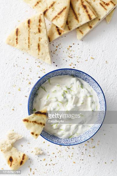 tzatziki dip and pita bread chips - tortilla flatbread stock pictures, royalty-free photos & images