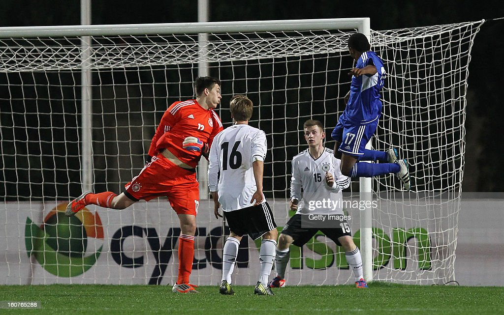 Tziama Christos (r) of Cyprus scores his team's first goal past goalkeeper Marius Gersbeck of Germany during the international friendly match between U18 Cyprus and U18 Germany at Stadio Tasos Markou on February 5, 2013 in Paralimni, Cyprus.