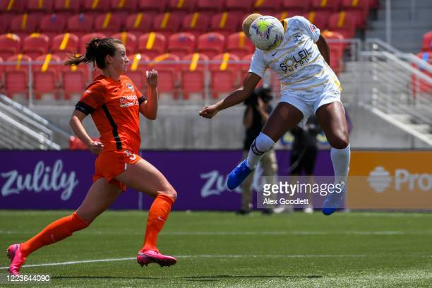 Tziarra King of the Utah Royals FC heads the ball for a goal in front of Cecelia Kizer of Houston Dash in the first round of the NWSL Challenge Cup...