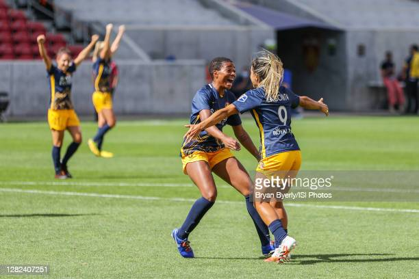 Tziarra King of Utah Royals FC and Lo'eau LaBonta celebrate a goal during a game between OL Reign and Utah Royals FC at Rio Tinto Stadium on...
