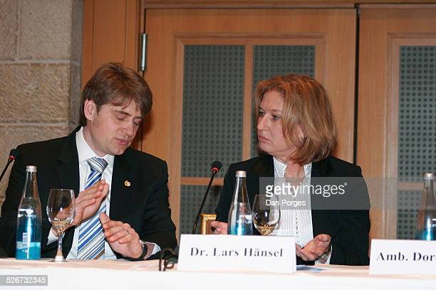 Tzipi Livni then Foreign Minister and currently Minister of Justice talking to Dr Lars Hensel head of the Israel Office of the Konrad Adenauer...