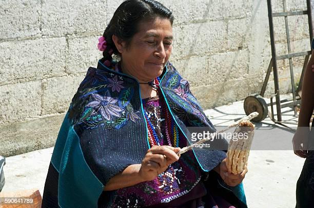 Tzotzil Maya Woman Preparing A Corn On A Cob Zinacantan Chiapas Mexico