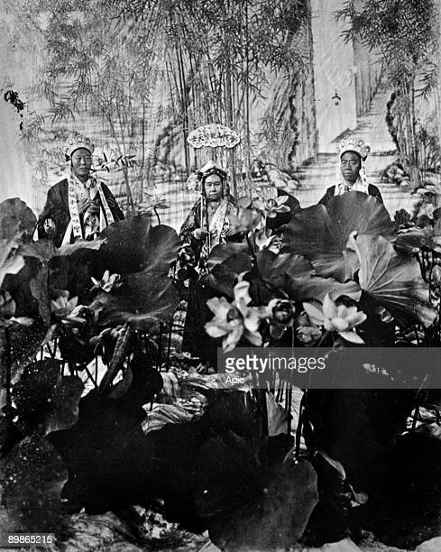 Tz'u Hsi Empress dowager of China here as buddhist goddess of mercy with Li Lienying chief eunuch photo attributed to princess der Ling 1903