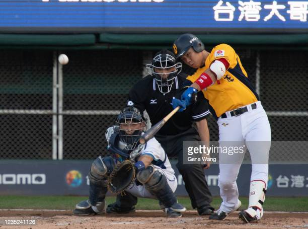 TzuHsien Chan of CTBC Brothers hit a two run homerun at the top of the 2nd inning during the CPBL game between Fubon Guardians and CTBC Brothers at...