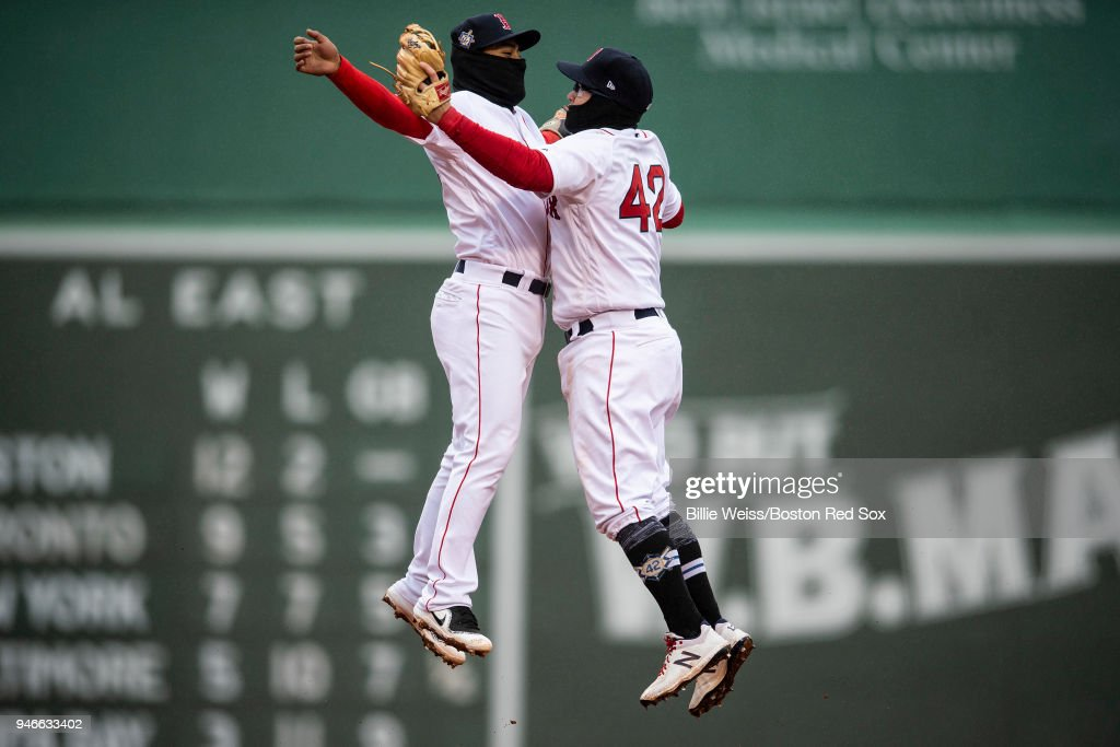 Tzu-Wei Lin #5 and Brock Holt #12 of the Boston Red Sox celebrate a victory against the Baltimore Orioles on April 15, 2018 at Fenway Park in Boston, Massachusetts.