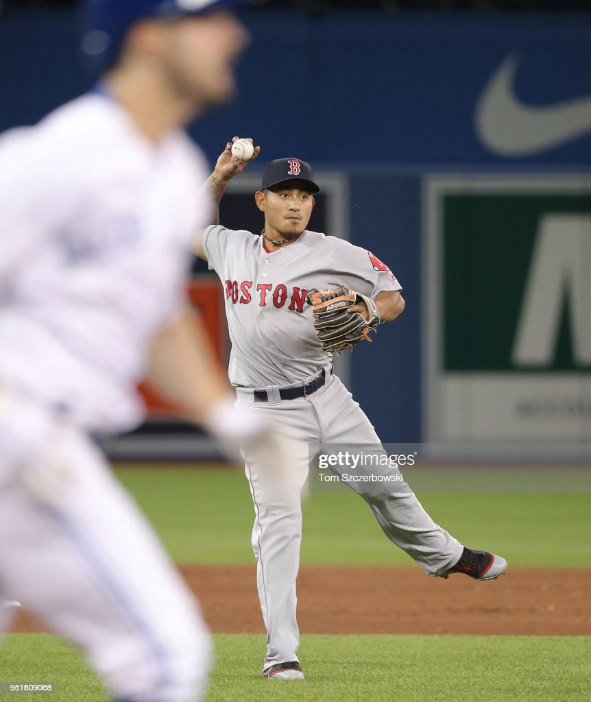 Tzu-Wei Lin #5 of the Boston Red Sox makes the play and throws out the baserunner in the eighth inning during MLB game action against the Toronto Blue Jays at Rogers Centre on April 26, 2018 in Toronto, Canada.