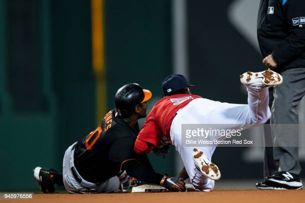 TzuWei Lin of the Boston Red Sox tags out Adam Jones of the Baltimore Orioles during the fourth inning of a game on April 13 2018 at Fenway Park in...