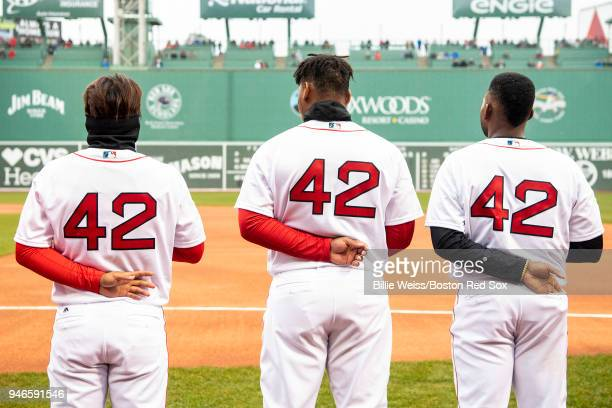 TzuWei Lin Rafael Devers and Jackie Bradley Jr #19 of the Boston Red Sox wear the number 42 in recognition of Jackie Robinson Day before a game...