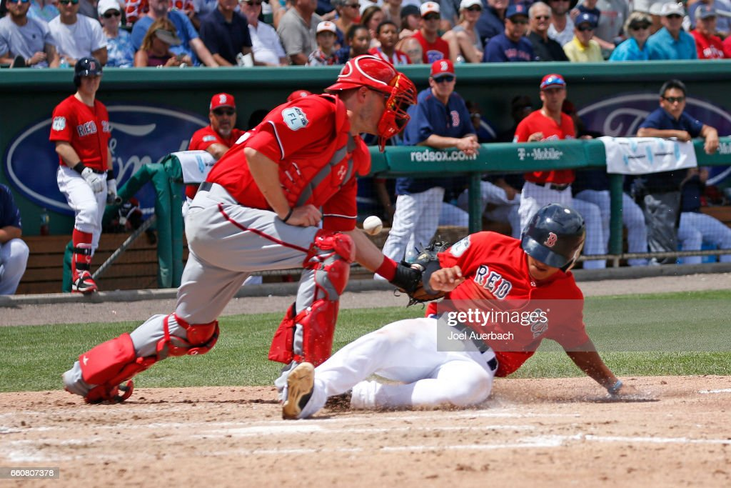 Tzu-Wei-Lin #17 scores on the hit by Jackie Bradley Jr. #19 of the Boston Red Sox as Matt Wieters #32 of the Washington Nationals is unable to control the ball in the third inning during a spring training game at JetBlue Park on March 30, 2017 in Fort Myers, Florida. The Red Sox defeated the Nationals 8-1.
