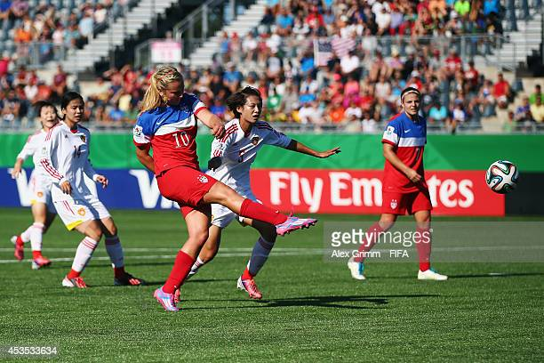 u10 of the United States scores her team's first goal during the FIFA U20 Women's World Cup Canada 2014 group B match between the United States and...