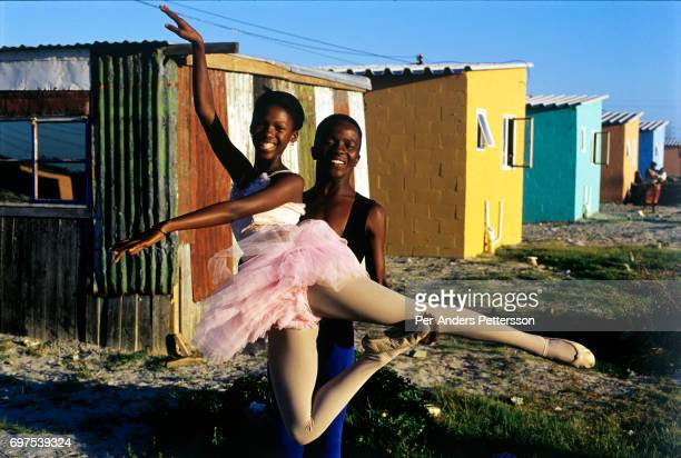 AFRICA 'u2013 JANUARY 30 Noluyanda Mqutwana a ballet dancer strikes a pose outside her small family house on January 30 2000 in Khayelitsha the...