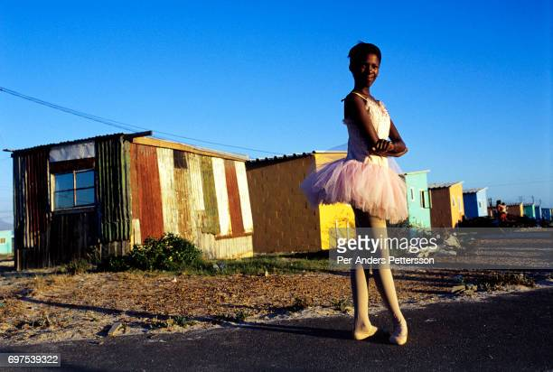 AFRICA 'u2013 JANUARY 30 Noluyanda Mqutwana a ballet student stands outside her small family house on January 30 2000 in Khayelitsha the biggest...