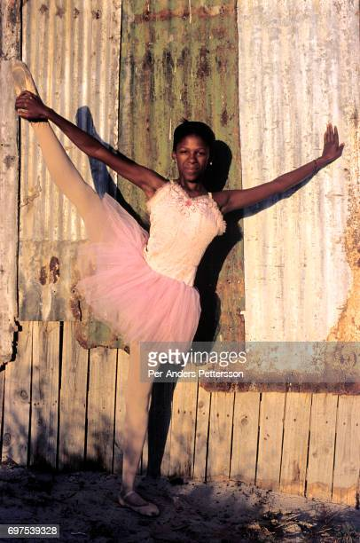 AFRICA 'u2013 JANUARY 30 Noluyanda Mqutwana strikes a pose outside her small family house on January 30 2000 in Khayelitsha the biggest black...