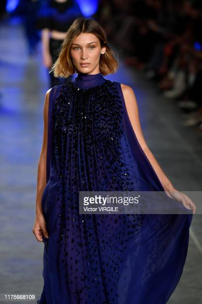 MILAN ITALY u2013 SEPTEMBER 18 Bella Hadid walks the runway at the Alberta Ferretti Ready to Wear Spring/Summer 2020 fashion show during Milan...