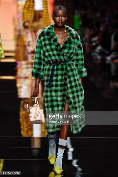 MILAN ITALY u2013 SEPTEMBER 19 Adut Akech walks the runway at the Fendi Ready to Wear fashion show during the Milan Fashion Week Spring/Summer 2020...
