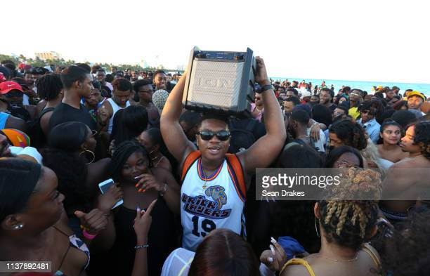 'u2018Wan Tha Don'u2019 carries a portable speaker playing rap music that gets people dancing as thousands of college students and nonstudents attend...