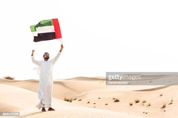 uae national day in the desert - uae national day stock photos and pictures