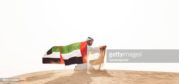 uae national day in the desert - united arab emirates flag stock photos and pictures