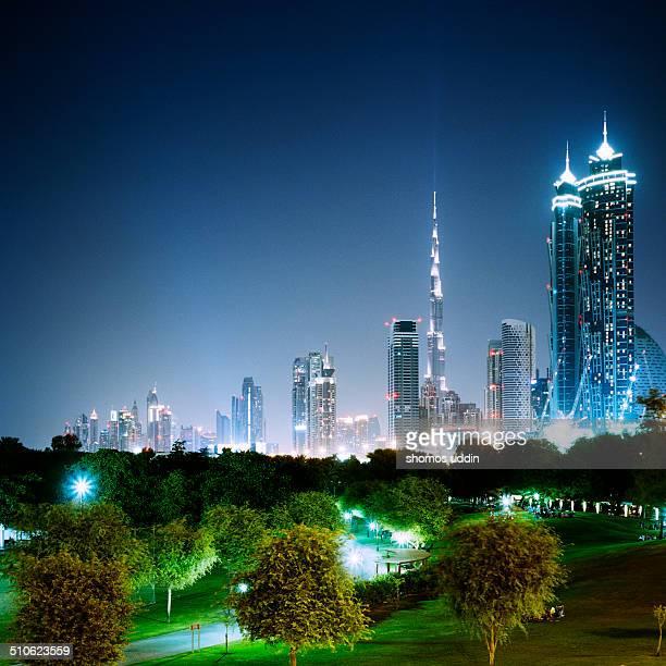 UAEDubaiView of Safa Park with Burj Khalifa and city skyline behind illuminated at night