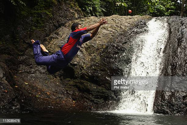 Uala Taitoe Kaisala of the Samoan Cricket Team dives into a pool of water below the Papasee'a waterfall to catch a cricket ball during a portrait...