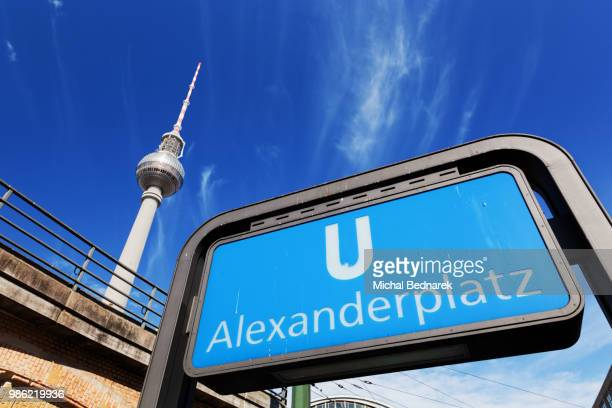 u-bahn alexanderplatz sign and television tower. berlin, germany - u bahn stock pictures, royalty-free photos & images