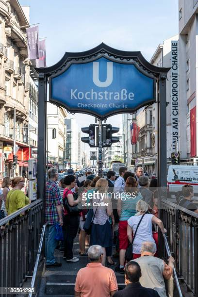 u-bahn entrance at checkpoint charlie in berlin, germany - u bahn stock pictures, royalty-free photos & images