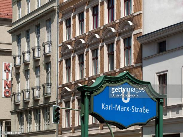 u-bahn karl marx strasse subway entrance sign, in the district of neukoelln, in berlin, germany - u bahn stock pictures, royalty-free photos & images