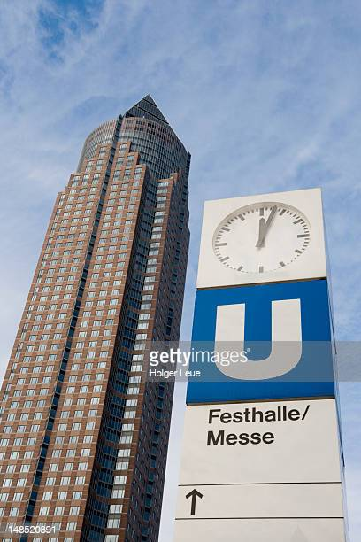 u-bahn sign and messeturm trade fair tower. - u bahn stock pictures, royalty-free photos & images
