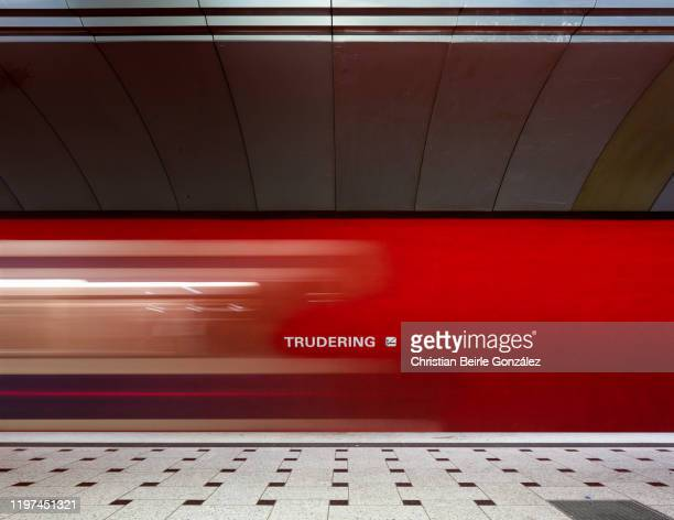 u-bahn station trudering with blurred movement of traveling subway, munich, germany - christian beirle stock pictures, royalty-free photos & images