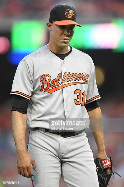 Ubaldo Jimenez of the Baltimore Orioles walks back to the dug out during a baseball game against the the Washington Nationals at Nationals Park on...