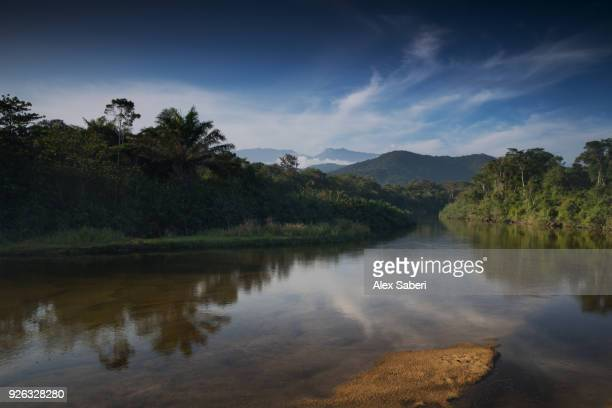 The river at Puruba at sunset with the mountains of the Serra do Mar National Park beyond.