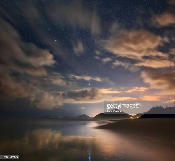 Stars and clouds on Itamambuca beach in the Atlantic rainforest.