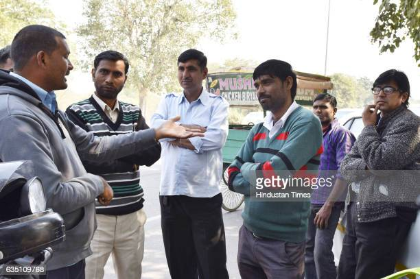 Uber cab drivers outside the Uber office at sector29 during the Uber and Ola Cab owners and drivers strike on February 13 2017 in Gurgaon India...