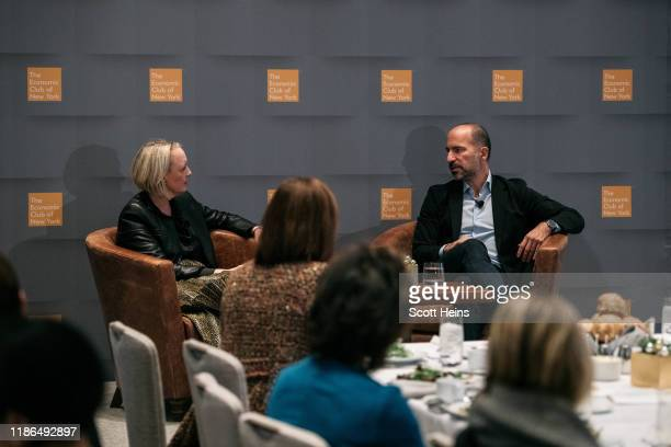 Uber CEO Dara Khosrowshahi speaks with Julie Sweet CEO of Accenture at a meeting of the Economic Club of New York in Manhattan on December 4 2019 in...