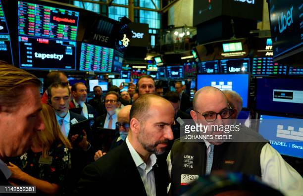 Uber CEO Dara Khosrowshahi talks to traders after the opening bell during his ride sharing company's IPO at the New York Stock Exchange on May 10 in...