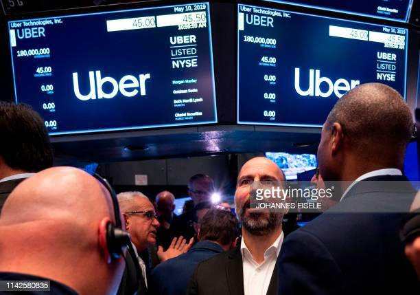 TOPSHOT Uber CEO Dara Khosrowshahi talks to traders after the opening bell during his ride sharing companie's IPO at the New York Stock Exchange on...